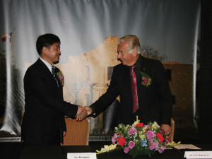 (Pictured L-R) Bingguo Liu, chairman and general manger of Yaqi Yantai Textile Co., Ltd., and Dr. Louis J. Agnese. Jr., UIW President, prepare to sign a memorandum of understanding at a ceremony held on April 22 at the Marriott Rivercenter Hotel.