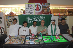Abdullah Madkhaly (second from right), a government-sponsored student and president of the Saudi Student Club; Phil Youngblood (center), computer information systems instructor; and members of the Saudi Student Club pose for a photo at Saudi Arabia National Day.