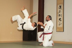 Swart demonstrates tekubi gaeshi nage, a  kenseido technique, with a pupil.