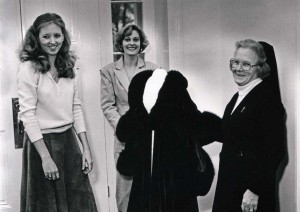 (Pictured L-R) Boyle, Harrell and Sr. Joyce pose with one of the gowns in 1986.  Photo courtesy of the Sisters of Charity of the Incarnate Word Archives.