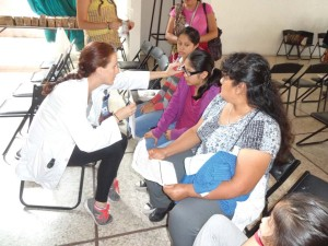Fourth year RSO student Raelyn Ottenbreit evaluates patients in Oaxaca, Mexico.