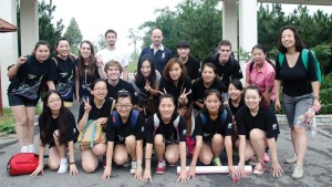 Danz (kneeling, fourth from left) on a group outing to a Chinese city called Qingdao, where they enjoyed authentic cuisine and hot springs.