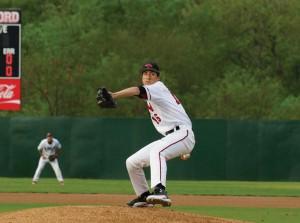 Encina pitches at Sullivan Field. Photo courtesy of Cardinal Athletics