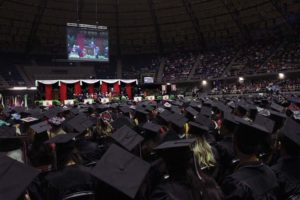 Graduates attend spring commencement.