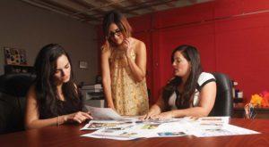 Morales, Duran and Najera review La Prensa layouts at their office in downtown San Antonio.