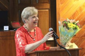 Moore speaks during a retirement celebration in April.