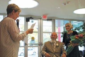 Light (left) says farewell to Norgan (center) as his wife looks on during Norgan's retirement celebration in April.