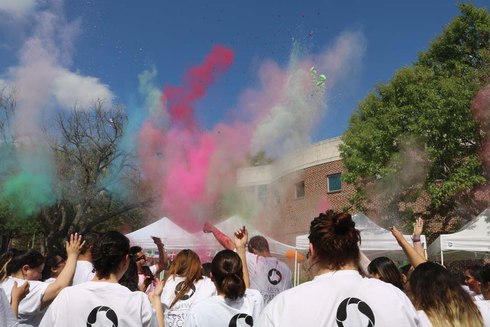 Students throw dye to celebrate the coming of spring.