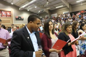 Recipients read the Alumni Association Oath during the ring ceremony.
