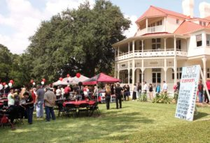 Employees attend this year's kickoff in front of the Brackenridge Villa.