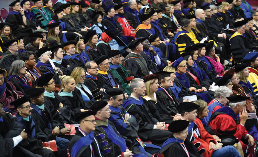 Faculty members, deans and visiting presidents attend the inauguration.