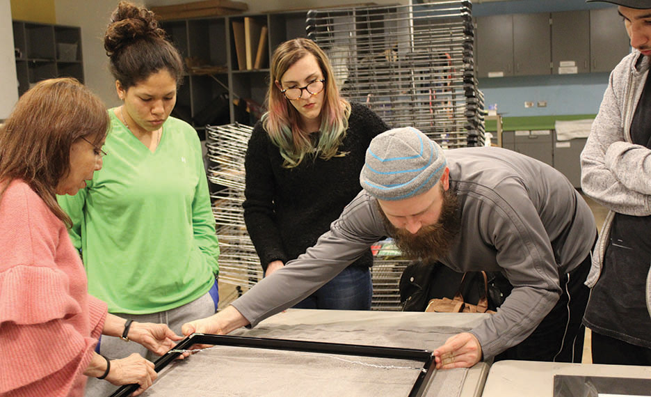 seniors practice framing techniques in preparation for the show. Photo by Bailey Rayner.