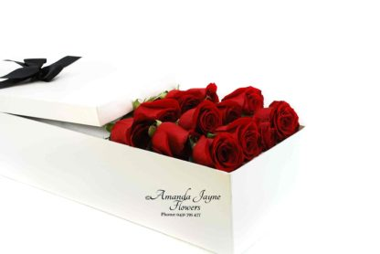 Dozen Red Roses in a presentation box.