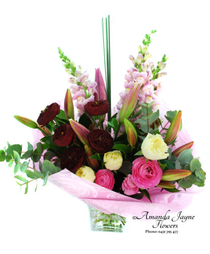 Noosaville Florist Red and Cream Roes bouquet.