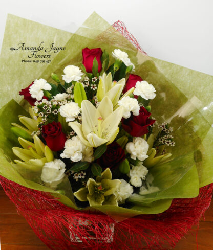 Bouquet of Red roses, white lilies and mix of white flowers