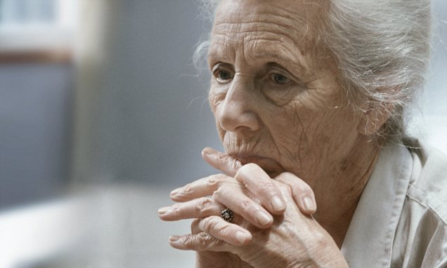 Senior Woman Looking Sad --- Image by © G. Baden/zefa/Corbis