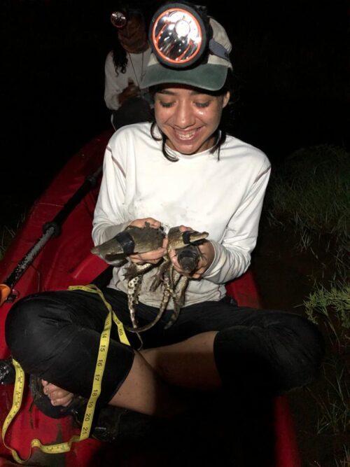 Jasmine holding crocs