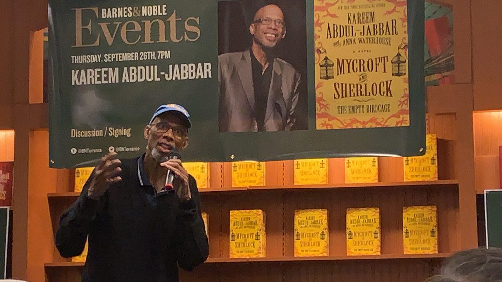 """Kareem Abdul-Jabbar speaking about his new mystery book, """"Mycroft and Sherlock : The Empty Birdcage"""" during a book signing and discussion event at Barnes and Noble in Torrance. (Photo by David Rice)"""