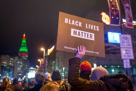 Demonstrators march on Ontario St. in Cleveland, Ohio, on Dec. 29, 2015