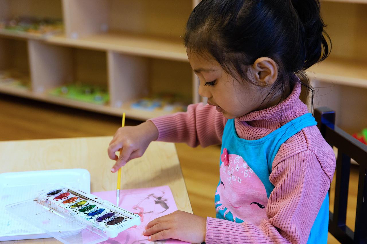 Montessori Toddler girl painting