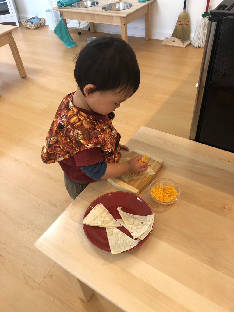 Toddler preparing lunch independently