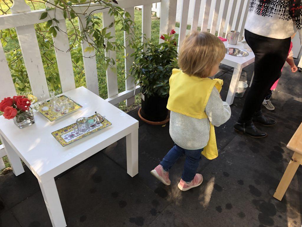 Toddler playing in a Montessori garden