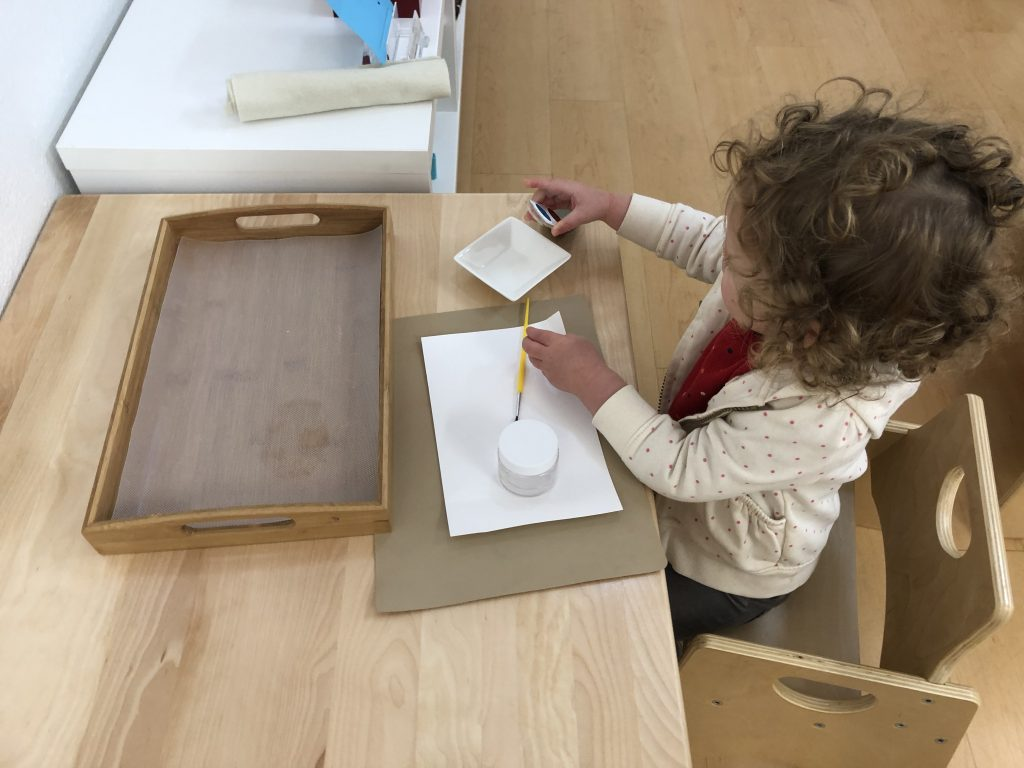 Toddler painting independently