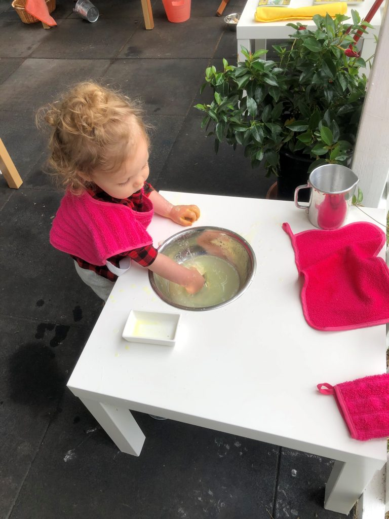 Toddler washing hands independently