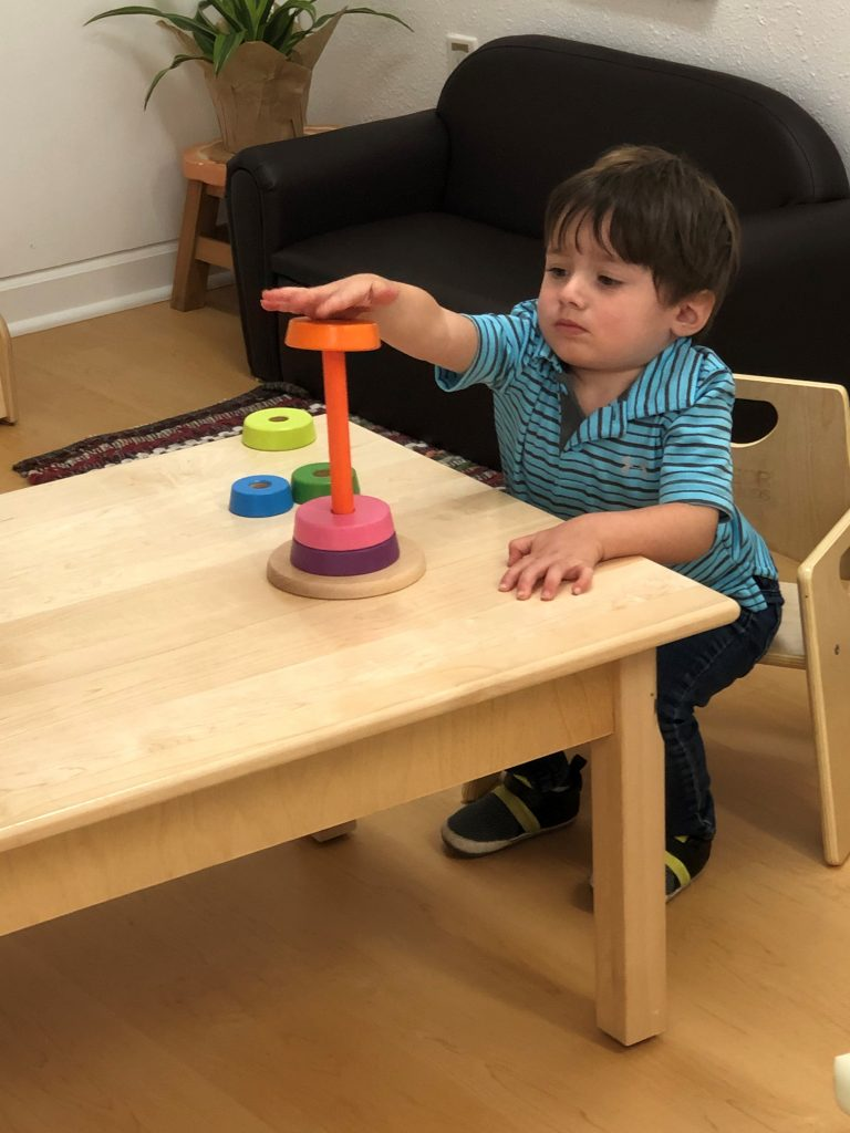 Toddler solving puzzles