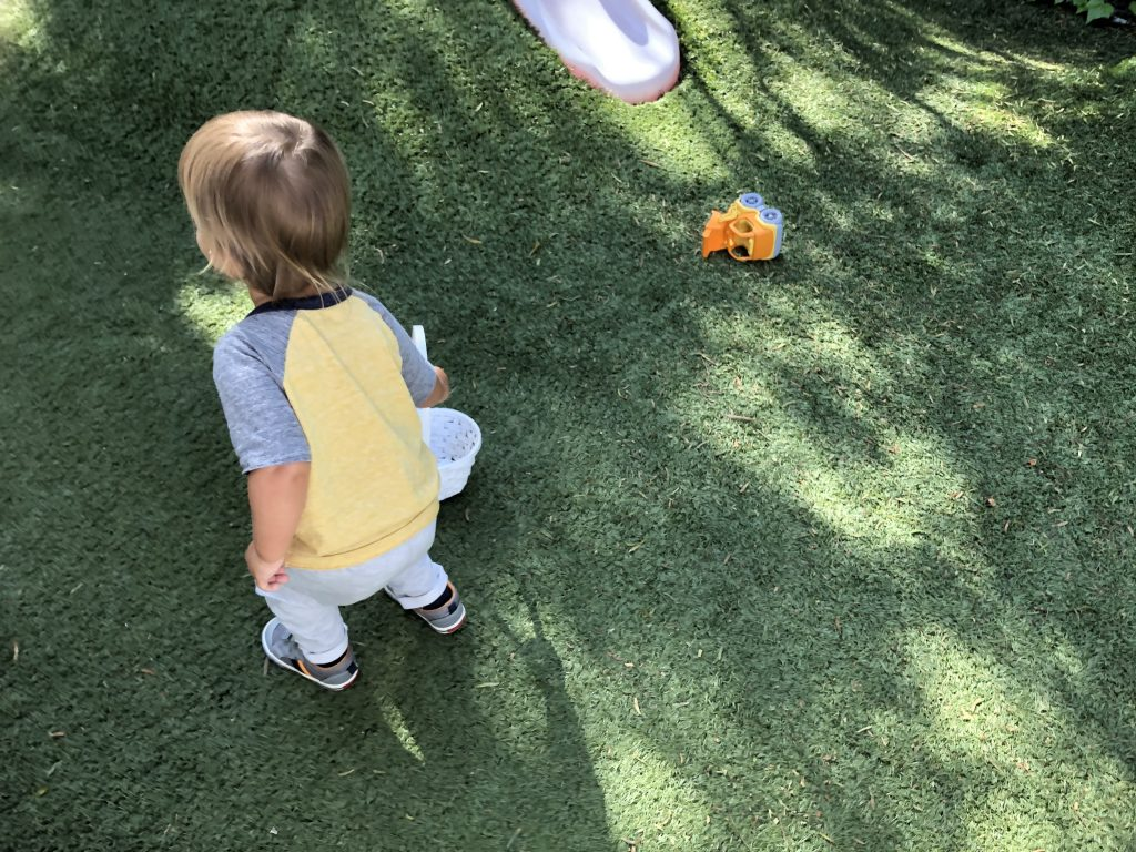 Toddler having fun at a Montessori playground