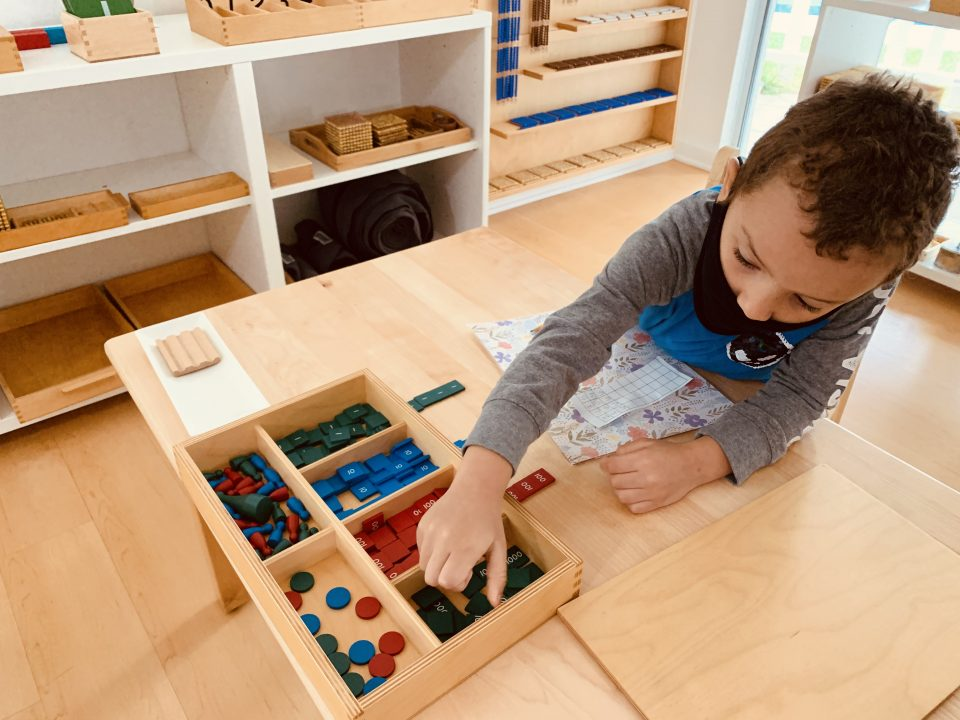 Preschooler learning Mathematical concepts at La Jolla Montessori School