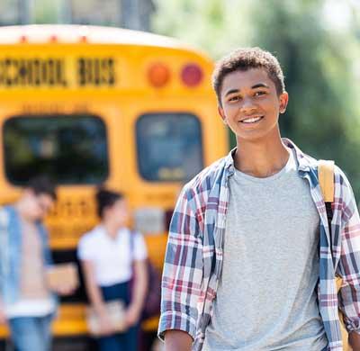 Happy Teen at school bus