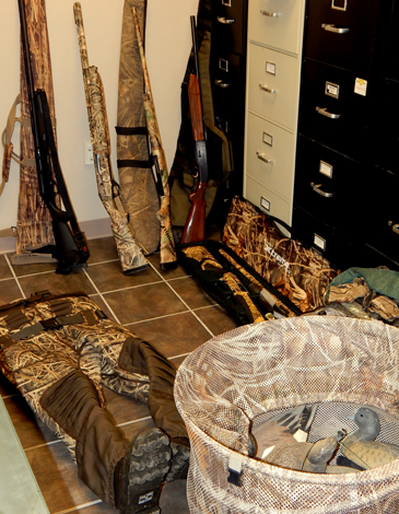 Shotguns, decoys, and a hunting outfilt stolen and recovered.