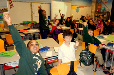 Students in Snyder's class hold up thJunior Deputy badges Eilers gave them.