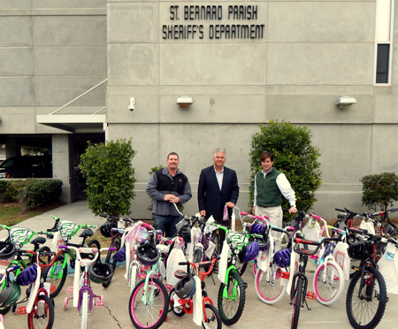 Associated Terminals of Chalmette donated  20 bicycles to the Sheriff's Office to give to needy children for Christmas. Shown with the bikes, from left, are Jason Perez, operations manager at Associated Terminals; Sheriff James Pohlmann and Zeljko Franks, Senior Vice-President.