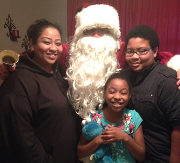 Christina Chapman of Arabi is shown with Santa, portrayed by Col. David Mowers, and Chapman's daughter, Taylor, and son, Adreon.