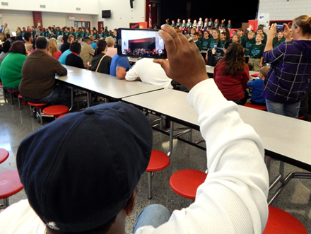 Parents video and take photos of students at Lacoste Elementary doing their D.A.R.E. song at the close of the ceremony.