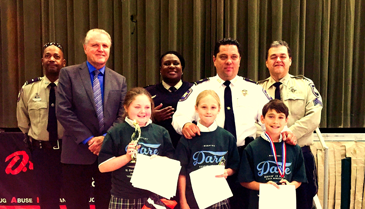 At Lynn Oaks School, D.A.R.E. essay winners in front row are Taylin Naquin, Megan Weiss and Anthony Perez. In back row are Lt. Richard Jackson, Chief Deputy Richard Baumy, D.A.R,E. program coordinator Lt. Lisa Jackson, Maj. Chad Clark and D.A.R.E. instructor Sgt. Darrin Miller.