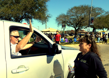 Sheriff James Pohlmann waves to the crowd.