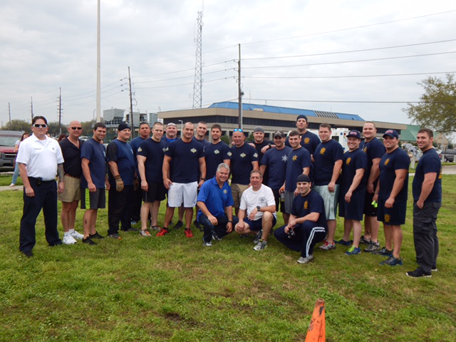 Participants from the Sheriff's and Fire department, with Sheriff James Pohlmann and Fire Chief Thomas Stone.