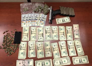 Marijuana, $2,359 in cash seized and a seized gun