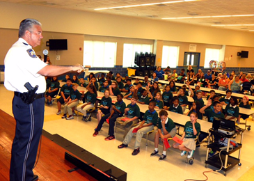 Sheriff James Pohlmann addresses D.A.R.E. graduates and parents at Chalmette Elementary.