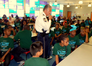 Sheriff Pohlmann talks to Willie Smith students grduating D.A.R.E.