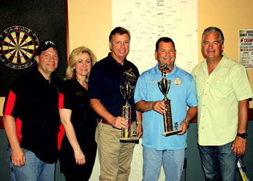 The winning team at the pool tournament was Kenner Police Chief Michael Glaser, third from left, and Deputy Chief Robert Meyer, next to him. both holding the trophies. With them are, from left, Anderson, Cusanza and Sheriff Pohlmann.