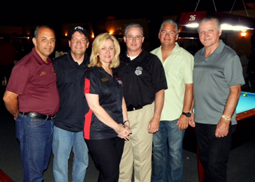 Shown at the law enforcement pool tournament in Chalmette are, from left, Plaquemines Parish Sheriff Lonnie Greco, FBI New Orleans office Special Agent in Charge Michael Anderson, Crimestoppers CEO and President Darlene Cusanza, Phillip Durham, Special Agent in Charge of the New Orleans ATF office; Sheriff James Pohlmann and Chief Deputy Sheriff Richard Baumy.