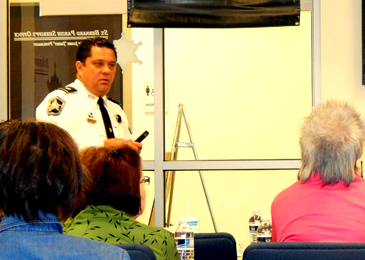 Maj. Chad Clark addresses the class on the fight against narcotics in the parish.