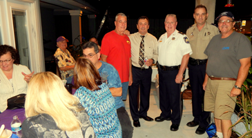 Raymond Dauterive, standing at left, at the Heart of Chalmette Neighborhood Association party he hosted on Park Boulevard. With him, from left,  are Sheriff's Office Det. Chuck Little, Maj. Adolph Kreger, Det. Lt. Richard Mendel and Steve Brandt of the association.
