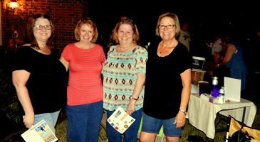 Neighbors at the party held by Gail Gowland, seconf from right, and Penny Hebert, at right, on West Carmack Drive.