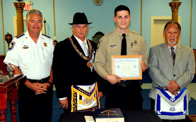 From left are Sheriff James Pohlmann, Master Sammy Shahine, Sheriff's Deputy Jordan Zulli and Past Master Richard Montelongo Sr. Zulli was honored for stopping a prisoner who tried to escape a hospital room in New Orleans after breaking restraints.