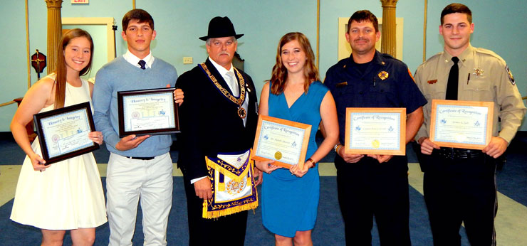 Andrew Jackson Lodge No. 428 F & AM recently held a ceremony at its lodge in Arabi to honor a St. Bernard sheriff's deputy, a firefighter, a teacher and two Chalmette High seniors. Shown from left are students Sarah Russell and Dominick Curole, Master Sammy Shahine, teacher Dr. Michelle Daussin of Joseph Davies Elementary. fire fighter Capt. Eric Crotwell and Sheriff's Deputy Jordan Zulli.